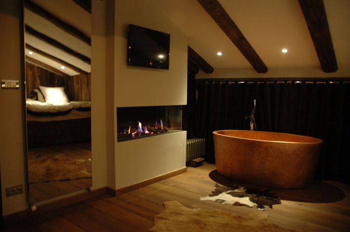 Bedroom 5 with wrap-around gas fire