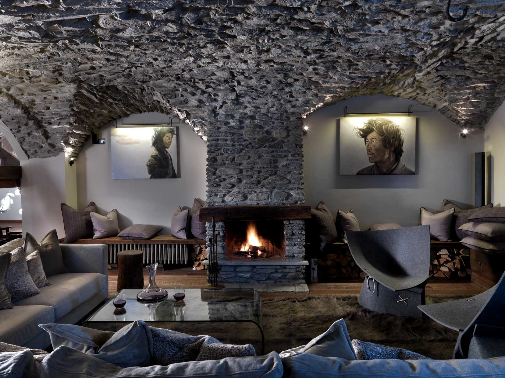 Living room with exposed stone vaulted ceiling and an open fire